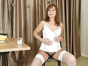 Sex-appeal older woman Rafaella shows striptease with an increment of plays with pussy